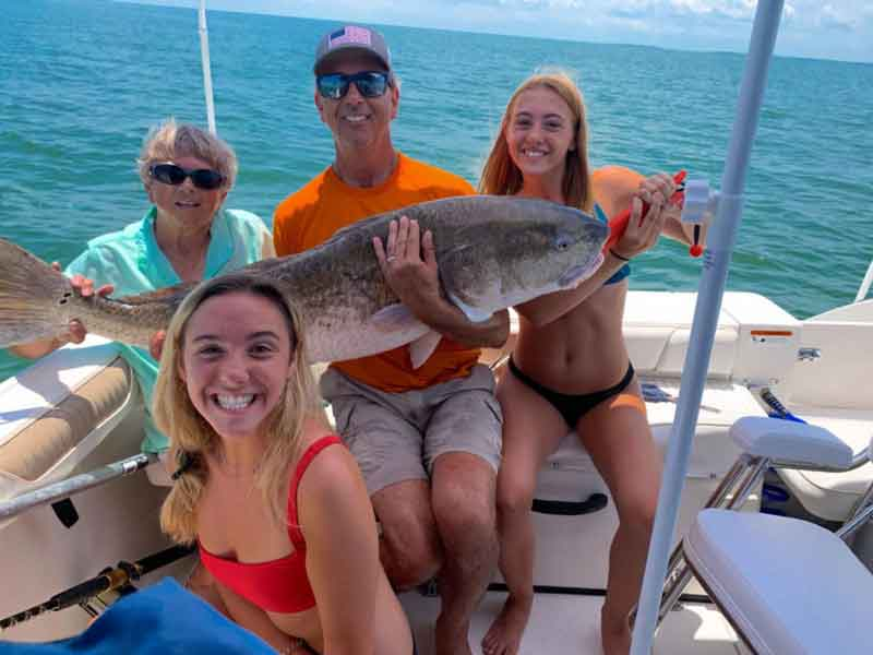 happy anglers with a cobia