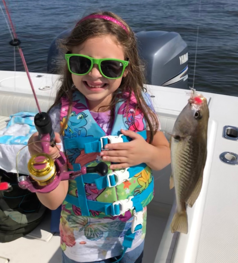 fisher girl catches a fish